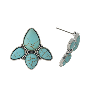"Fanned turquoise stud earrings on a silver tone backing. Approximately 1"" in length and width."