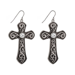"Silver tone cross earrings with a clear rhinestone. Approximately 1.75"" in length."