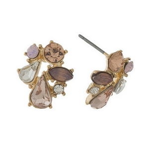 "Gold tone stud earrings featuring shades of pink glass faceted stones. 1/2"" in length."