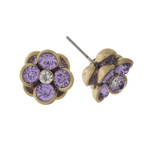 "Burnished gold tone, flower shaped, stud earrings with lavender rhinestones. Approximately 1/2"" in diameter."