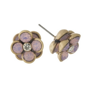 Burnished gold tone, flower shaped, stud earrings with pale pink rhinestones. Approximately 10mm diameter.