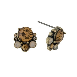 "Burnished gold tone stud earrings with topaz rhinestones. Approximately 1/2"" in length."