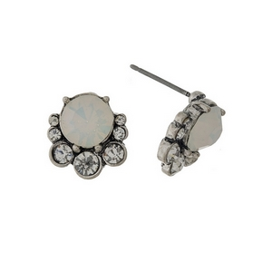 "Burnished silver tone stud earrings with opal rhinestones. Approximately 1/2"" in length."