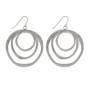 "Matte silver tone fishhook earrings with cascading circles. Approximately 1.5"" in length."