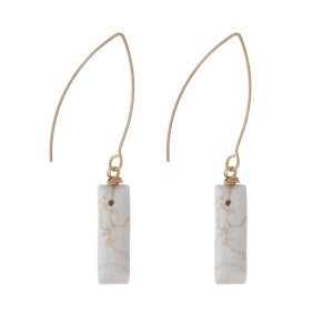 "Gold tone, long hook earrings with an ivory stone. Approximately 1.5"" in length."