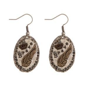 "Burnished two tone fishhook earrings, stamped with ""Brave."" Approximately 1"" in length."