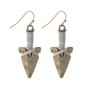 "Hammered gold tone arrowhead earrings with silver tone wire wrapping detail. Approximately 1.25"" in length."