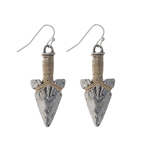 "Hammered silver tone arrowhead earrings with gold tone wire wrapping detail. Approximately 1.25"" in length."