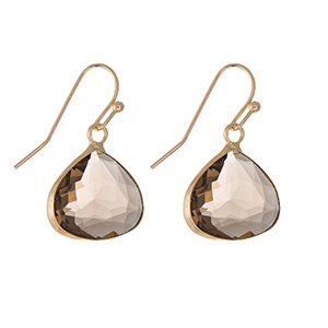 "Gold tone fishhook earrings featuring a gray glass faceted stone (15mm) measuring 1"" in length."