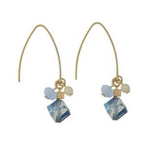 """Gold tone, long hook earrings with a blue beaded cluster. Approximately 1.25"""" in length from top of the hook to bottom of beads."""