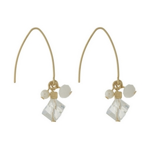"""Gold tone, long hook earrings with a clear and opal beaded cluster. Approximately 1.25"""" in length from top of the hook to bottom of beads."""