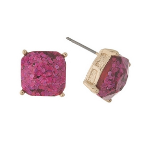 "Gold tone stud earrings with pink glitter. Approximately 1/2"" in length."