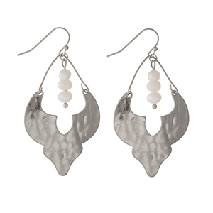 "Hammered silver tone fishhook earrings with three freshwater pearl beads. Approximately 1.25"" in length."