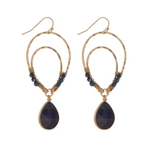 """Gold tone fishhook earrings with an upside down teardrop shape and navy blue beads. Approximately 3"""" in length."""