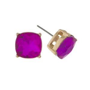 "Gold tone stud earrings with a pink rhinestone. Approximately 1/2"" in width."