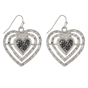 "Silver tone fishhook earrings in the shape of a heart with hematite stones. Approximately 1.25"" in length."