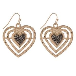"Gold tone fishhook earrings in the shape of a heart with hematite stones. Approximately 1.25"" in length."