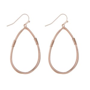"Rose gold tone fishhook earrings displaying a wire wrapped teardrop. Approximately 1.5"" in length."