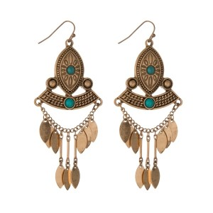 """Burnished gold tone tribal fishhook earrings with turquoise stones. Approximately 3"""" in length."""