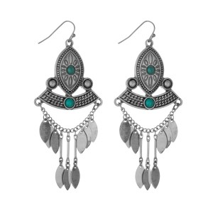 """Burnished silver tone tribal fishhook earrings with turquoise stones. Approximately 3"""" in length."""
