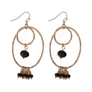 "Gold tone fishhook earrings with an open oval shape and black faceted beads. Approximately 2"" in length."