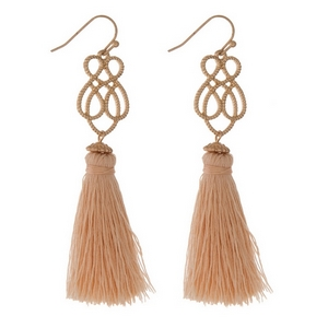 "Gold tone fishhook earrings with a swirl design and a blush pink tassel. Approximately 3"" in length."