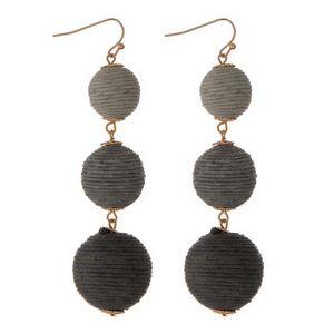 """Gold tone fishhook earrings featuring gray ombre, thread wrapped balls. Approximately 3"""" in length."""