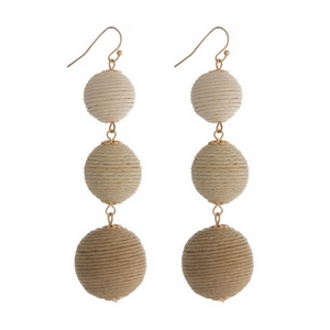 """Gold tone fishhook earrings featuring tan ombre, thread wrapped balls. Approximately 3"""" in length."""