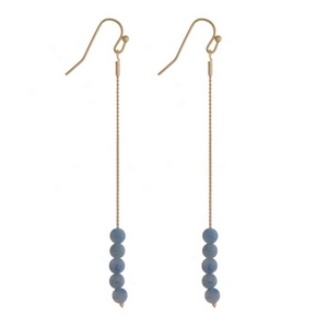 "Gold tone fishhook earrings with blue natural stone beads. Approximately 3"" in length."