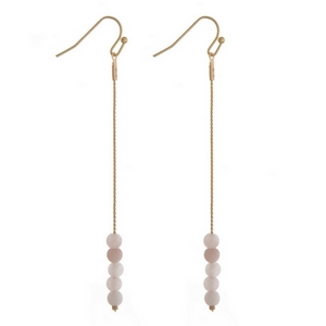 "Gold tone fishhook earrings with rose quartz natural stone beads. Approximately 3"" in length."