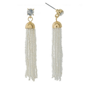 """Gold tone post style earrings featuring a clear beaded tassel and rhinestone accent. Approximately 2.5"""" in length."""