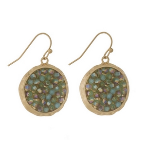 "Gold tone fishhook earrings featuring a mint green beaded circle. Approximately 1"" in diameter."