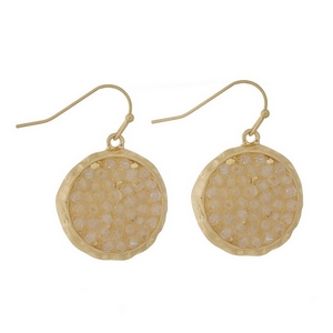 """Gold tone fishhook earrings featuring a opal beaded circle. Approximately 1"""" in diameter."""