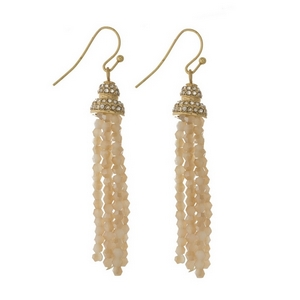 """Gold tone fishhook earrings featuring an ivory beaded tassel and clear rhinestones. Approximately 2.5"""" in length."""