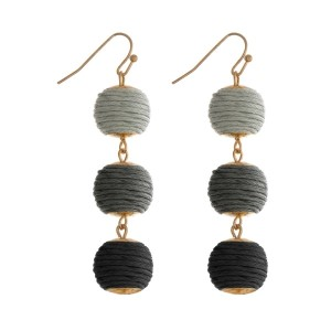 """Gold tone fishhook earrings featuring gray ombre, thread wrapped balls. Approximately 2"""" in length."""
