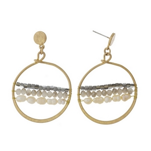 """Gold tone fishhook earrings featuring an open circle shape, gray beads and freshwater pearl beads. Approximately 1.5"""" in length."""
