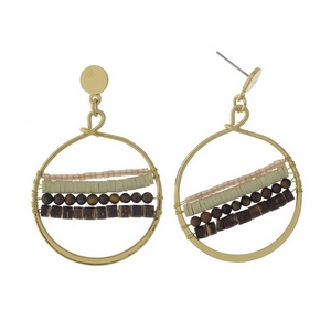 """Gold tone fishhook earrings featuring an open circle shape, brown wooden beads, mint and pink beads. Approximately 1.5"""" in length."""