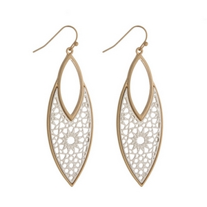 "Gold tone fishhook earrings featuring a two tone filigree oval shape. Approximately 2.5"" in length."