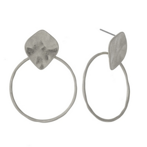 "Silver tone post earrings featuring a hammered square shape and an open circle. Approximately 1.5"" in length."