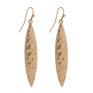 """Gold tone fishhook earrings featuring a hammered oval shape. Approximately 2"""" in length."""