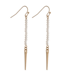 "Dainty gold tone fishhook earrings featuring opal faceted beads and a spike pendant. Approximately 2"" in length."
