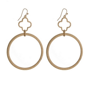 """Gold tone fishhook earrings with an open clover and an open circle shape. Approximately 3"""" in length."""