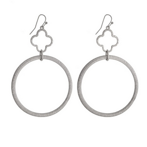 """Silver tone fishhook earrings with an open clover and an open circle shape. Approximately 3"""" in length."""