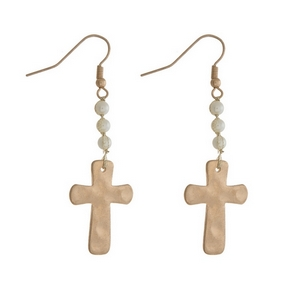 """Gold tone fishhook earrings with a hammered cross and pearl bead accents. Approximately 2"""" in length."""