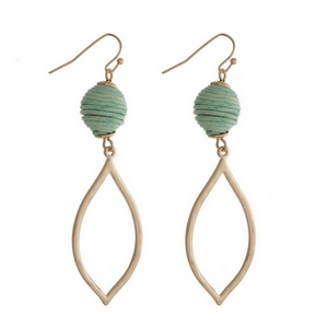 """Gold tone fishhook earrings with a mint green thread wrapped ball and an open teardrop shape. Approximately 2.5"""" in length."""