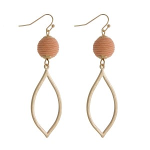 "Gold tone fishhook earrings with a peach thread wrapped ball and an open teardrop shape. Approximately 2.5"" in length."