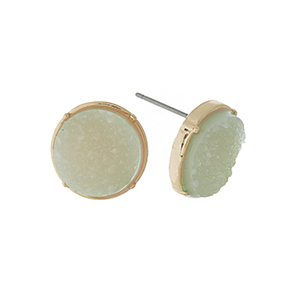 "Gold tone stud earrings with a mint green, circle shaped faux druzy stone. Approximately 1/2"" in diameter."