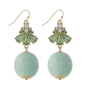 "Gold tone fishhook earrings with clear rhinestones and a mint green thread wrapped ball. Approximately 2.25"" in length."