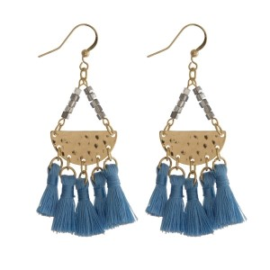 """Gold tone fishhook earrings featuring a hammered half circle with five, light blue fabric tassels. Approximately 2.5"""" in length."""