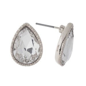 """Silver tone teardrop stud earrings with a clear rhinestone. Approximately 1/2"""" in length."""